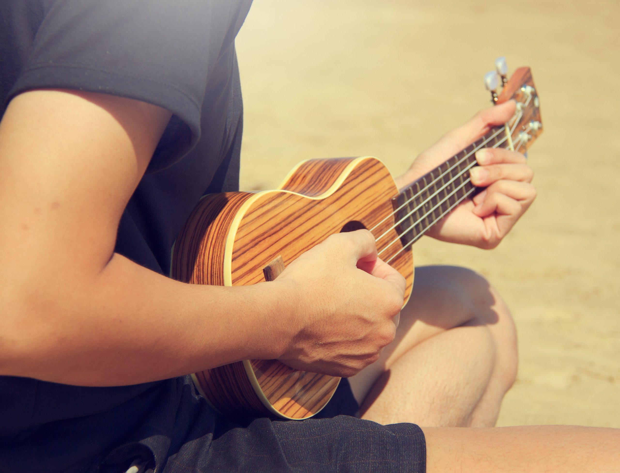Strumming a ukulele